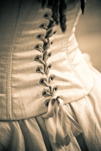 Close up of corset, sepia tone image ** Note: Slight graininess, best at smaller sizes